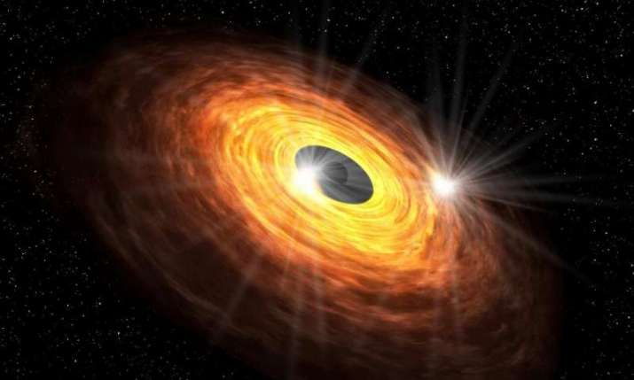Hot spots circling around the black hole could produce the quasi-periodic millimeter emission detect