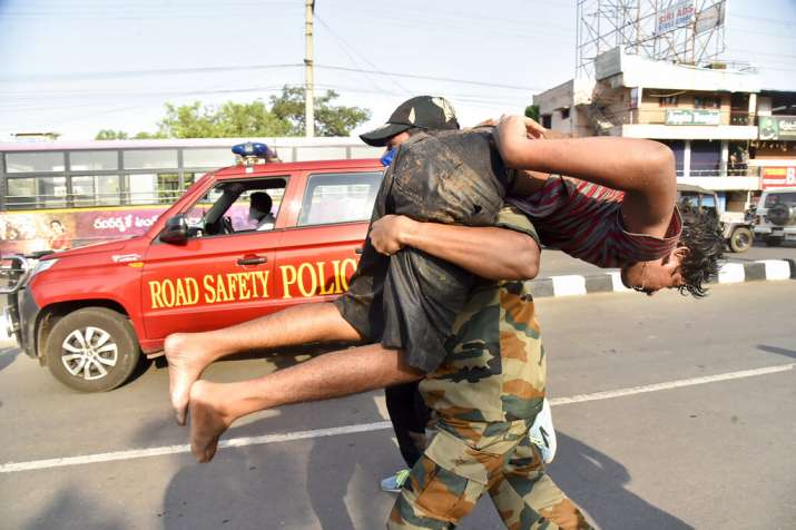 India Tv - A boy affected by a chemical gas leak is carried for medical treatment in Vishakhapatnam