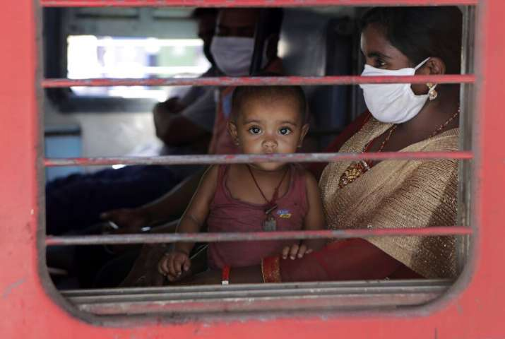 A child looks on as a special train transporting migrant workers to Bihar leaves Thane, in the weste