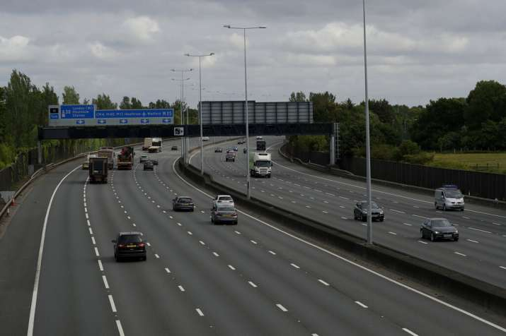 Traffic passes along the M25 London orbital motorway at just before 09:15am local time, near the tow