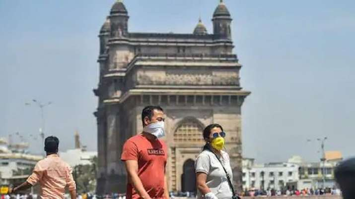 File photo of tourists wearing protective masks in view of