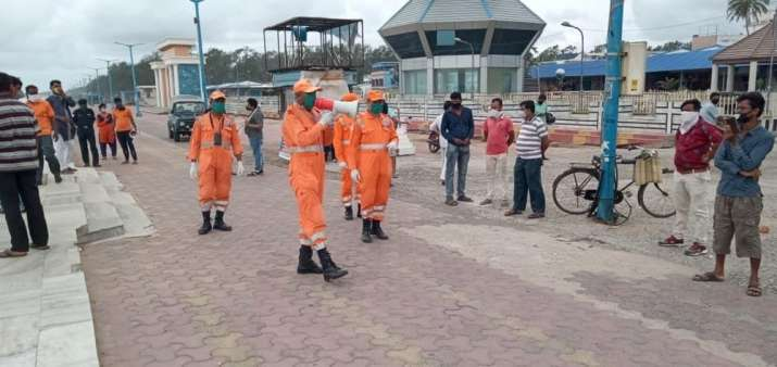 This image shows NDRF personal making announcements to warn
