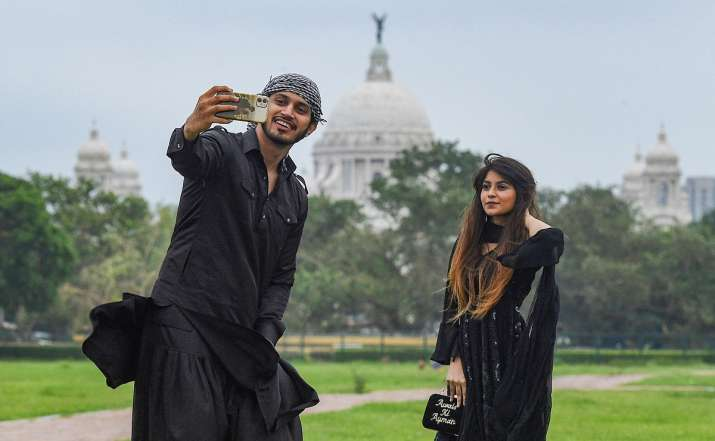 India Tv - Kolkata: Youth click photographs while celebrating Eid-ul-Fitr at a park, during the ongoing COVID-19 lockdown, in Kolkata, Monday, May 25, 2020.