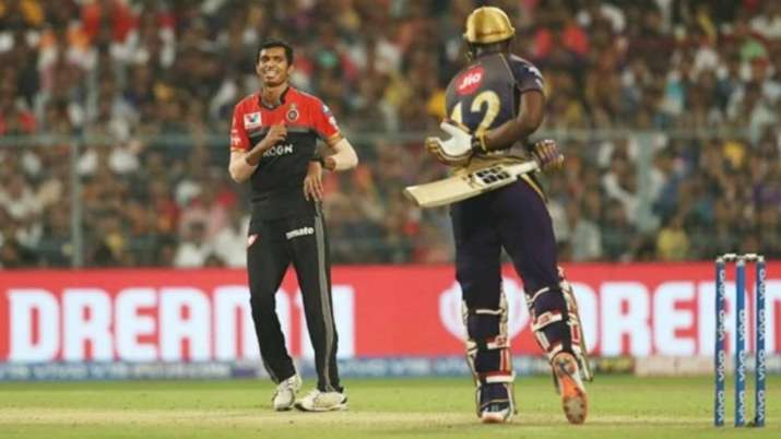 Navdeep Saini in action against Andre Russell