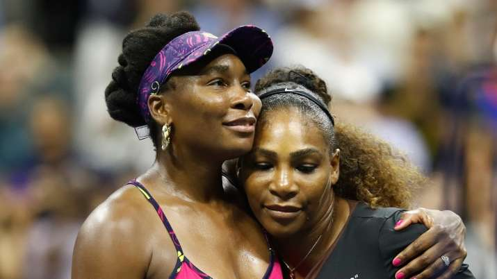 Stretch it out: Serena, Venus Williams offer fans yoga tips