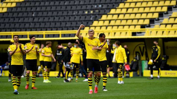 Fist bumps and masks: Borussia Dortmund rout Schalke 4-0 on Bundesliga return