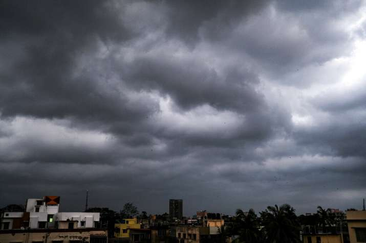 Rain clouds hover over the city in Kolkata, India, Wednesday, May 27, 2020. Southerly winds from the