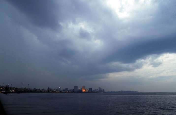 Rain clouds fill the sky on the Arabian Sea coast in Mumbai, India, Tuesday, June 2, 2020. Cyclone N