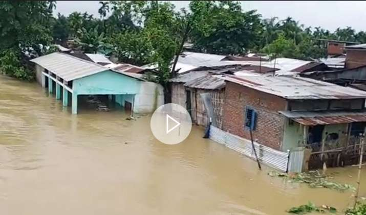 India Tv - Screenshot from a video of a flooded area in Assam's Tinsukia district.
