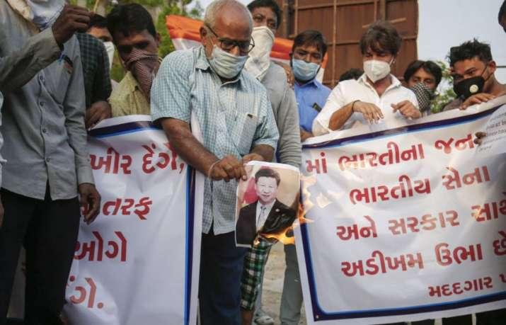 Ahmedabad: Demonstrators burn posters of Chinese President