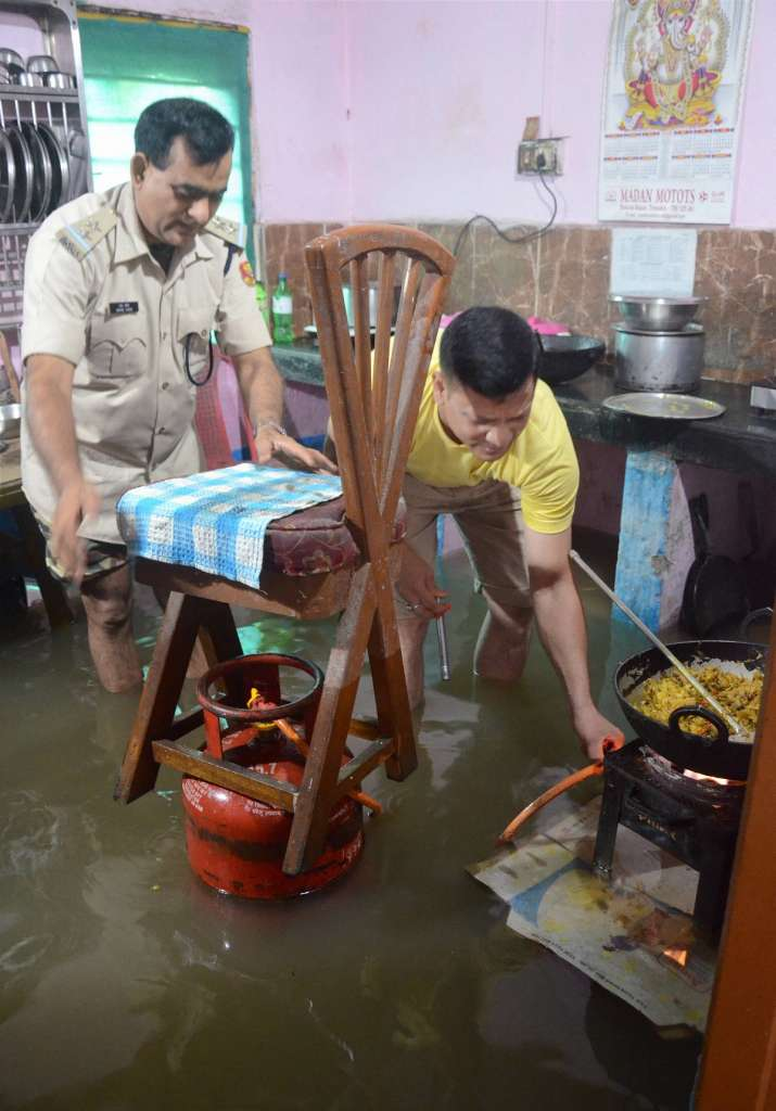India Tv - Dibrugarh: Central Reserve Police Force (CRPF) personnel prepare food inside a flooded CRPF headquarter following heavy Monsoon rain in the area, in Dibrugarh district, Wednesday, June 24, 2020.