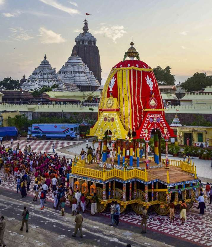 India Tv - Priests and policemen pull the three chariots of Lord Jagannath, Balarama, and Subhadra from the con