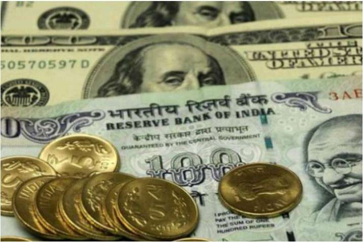 Rupee gains 7 paise to 75.51 against dollar on weak crude oil