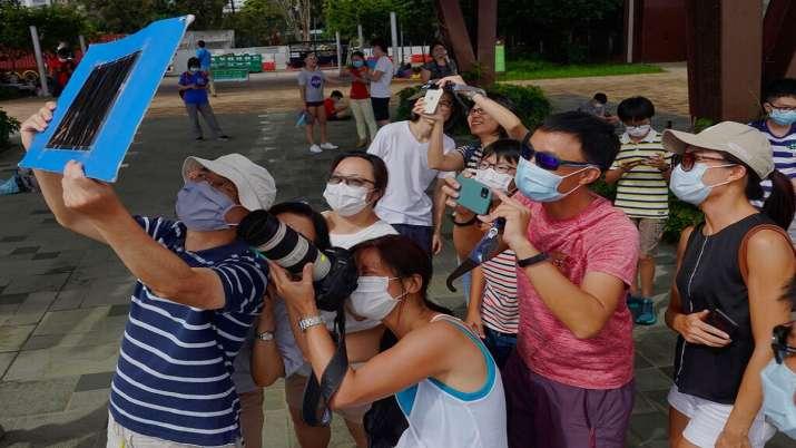 India Tv - Solar Eclipse 2020, Solar Eclipse Hong Kong, Solar eclipse photos, Solar eclipse world photos