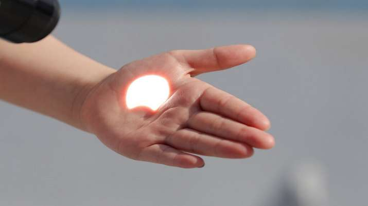 India Tv - Solar Eclipse 2020, Solar Eclipse South Korea, Solar eclipse photos, Solar eclipse world photos