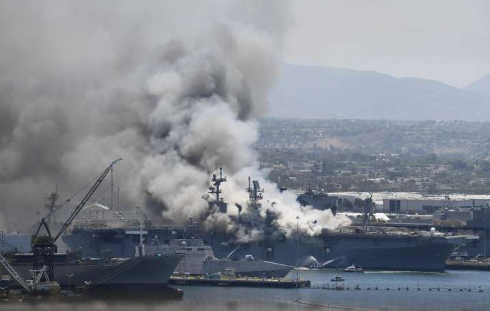 Smoke rises from the USS Bonhomme Richard at Naval Base San Diego Sunday, July 12, 2020, in San Dieg
