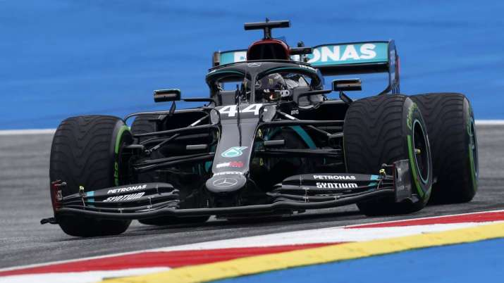 Lewis Hamilton takes pole position at F1's rain-soaked