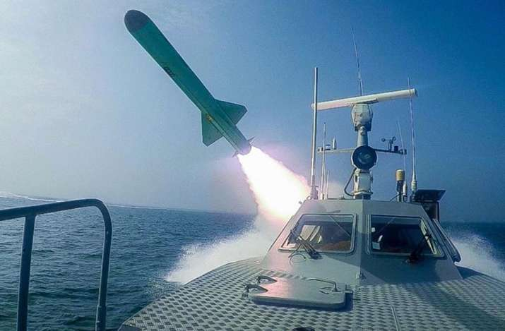 India Tv - A Revolutionary Guard's speed boat fires a missile during a military exercise. Iranian commandos als