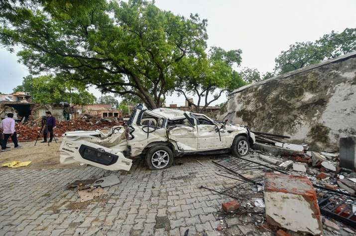 Kanpur: Mangled remains of a car at demolished residence of