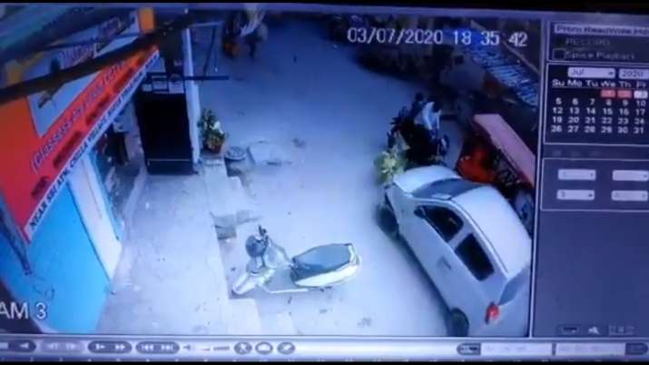 Disturbing CCTV footage shows the speeding car with the woman on its bonnet