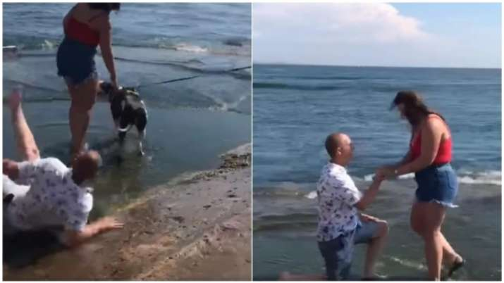Man literally falls in love as he slips on beach before proposing, video goes viral