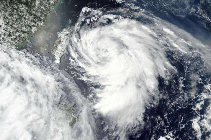 This Monday, Aug. 3, 2020, satellite image released by NASA shows Typhoon Hagupit over Taiwan, cente