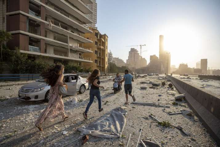 India Tv - People run in the aftermath of a massive explosion in Beirut, Lebanon, Tuesday, Aug. 4, 2020. (AP Ph