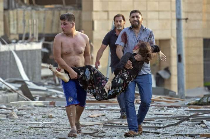 India Tv - A wounded woman is evacuated after a massive explosion in Beirut, Lebanon, Tuesday, Aug. 4, 2020. (A