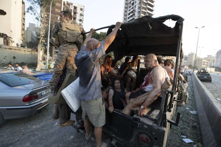 India Tv - Injured people are evacuated after a massive explosion in Beirut, Lebanon, Tuesday, Aug. 4, 2020. (A