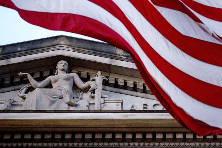 In this March 22, 2019 file photo, an American flag flies outside the Department of Justice in Washi