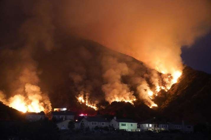 The Ranch Fire burns over a residential area, Thursday, Aug. 13, 2020, in Azusa, Calif. Heat wave co