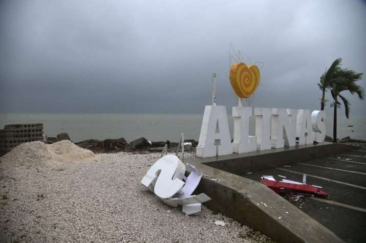Remnants of a city sign lay on the beach damaged by Tropical Storm Laura in Salinas, Puerto Rico, Sa