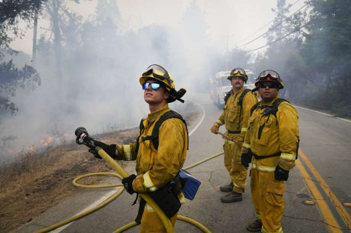 Firefighters Cody Nordstrom, Kyle Harp and Robert Gonzalez, from left, of the North Central Fire sta