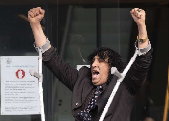Mosque shooting victim Taj Mohammad Kamran reacts as he leaves the Christchurch High Court after the