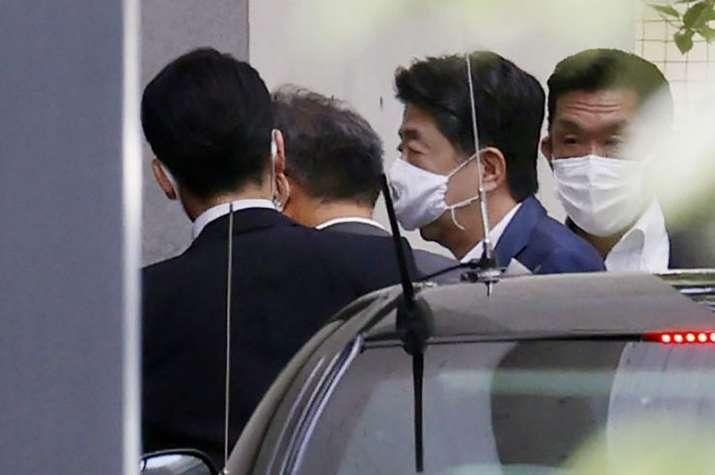 Japanese Prime Minister Shinzo Abe, center right, arrives at Keio University Hospital in Tokyo Monda