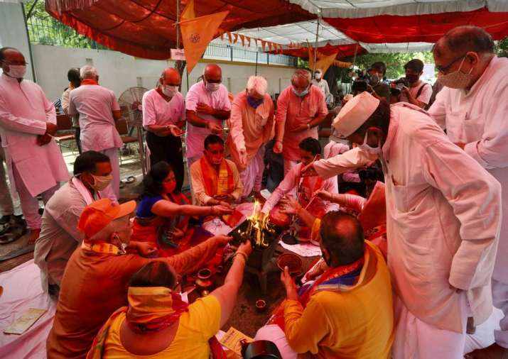 Hindus offer prayers for a groundbreaking ceremony of a