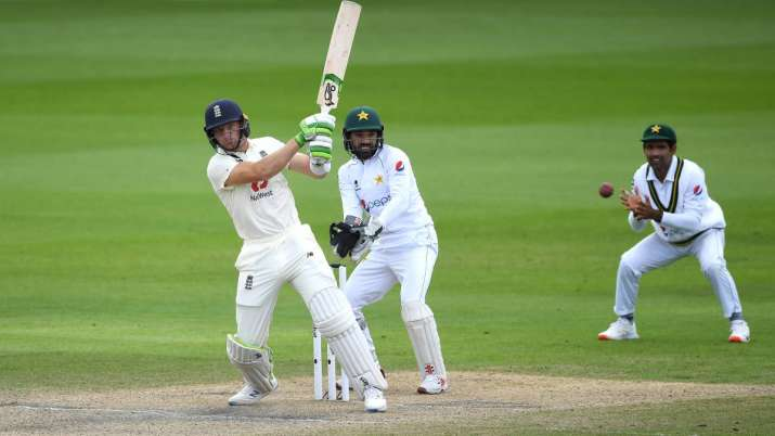 Jos Buttler of England hits out watched on by Mohammad