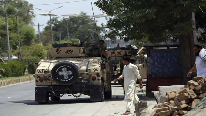 Islamic State attack on Afghan prison, killing 21, rages on