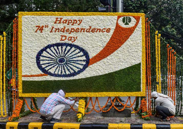 India Tv - New Delhi: NDMC workers decorate a board with flowers to wish people on 74th Independence Day, in New Delhi Friday, Aug. 14 2020.