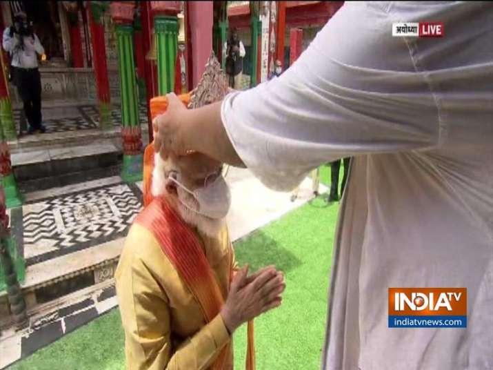 PM Modi wears Silver Mukut from Hanumangarhi Mandir priest before heading for Ram Lalla | Photos
