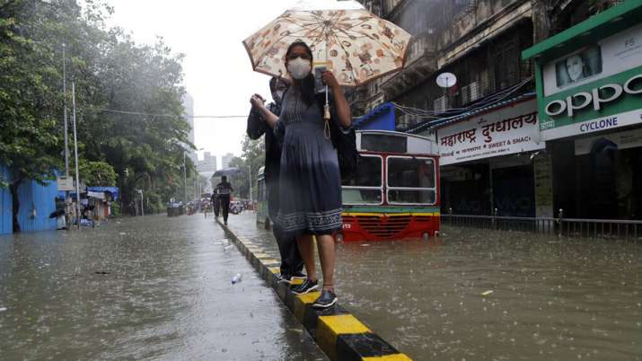 India Tv - water logged street during heavy rain in Mumbai, India, Tuesday, Aug. 4, 2020