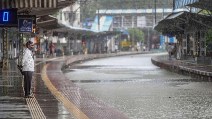 India Tv - Mumbai: Waterlogged railway tracks at Chunabhatti railway station following heavy rainfall