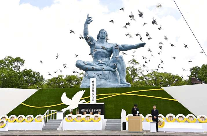 India Tv - Doves fly over the Statue of Peace during a ceremony at Nagasaki Peace Park in Nagasaki, southern Ja