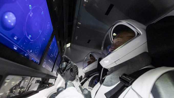 SpaceX capsule returns with 2 NASA astronauts from space station