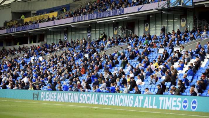 Brighton soccer fans adhere to social distancing measures