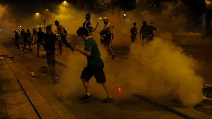 Fans clash with Paris riot police after PSG lose Champions League final