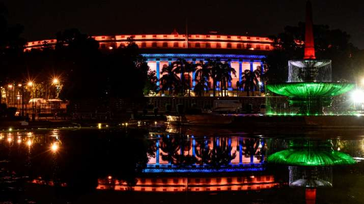India Tv - Parliament House illuminated on the eve of Independence Day, in New Delhi, Friday, Aug. 14, 2020. (P