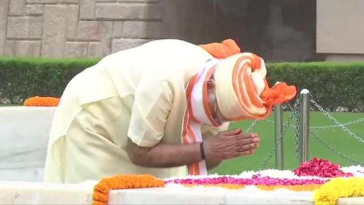 India Tv - Prime Minister Narendra Modi pays tributes at Raj Ghat