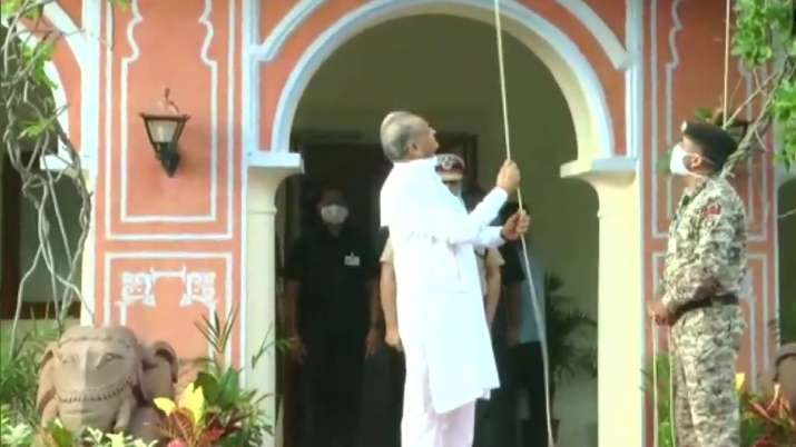 India Tv - Chief Minister Ashok Gehlot hoists the National Flag at his residence in Jaipur