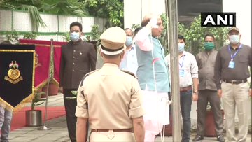 India Tv - Defence Minister Rajnath Singh unfurls tricolor at his residence.
